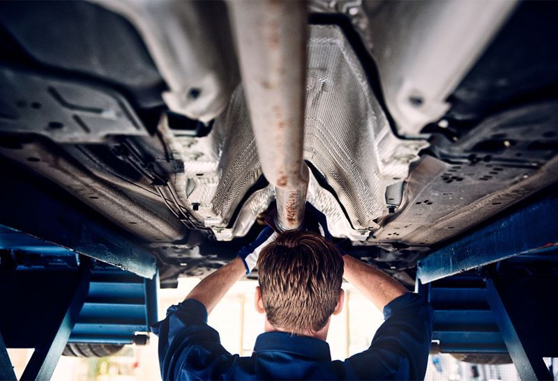 Volvo Technician working on vehicle